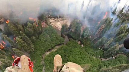 USA: National Guard dump water on wildfire from helicopter in California