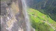 Красив полет през водопад над Швейцария