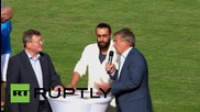 Germany: DFB president kicks off football match between refugees and local team