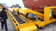 Ето как се разтоварват огромните и тежки товарни вагони