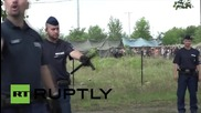 Hungary: Riot police use tear as refugees attempt to break out of detention camp