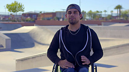 US Wheelchair athlete performs daredevil tricks and stunts at skate park