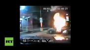 USA: Police dash-cam captures attempted self-immolation at gas station
