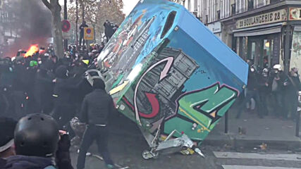 France: Clashes erupt and fires rage as Parisians protest security bill