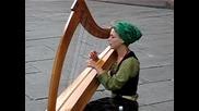Beautiful girl singing in Strasbourg on harp(league of legends - Sona)
