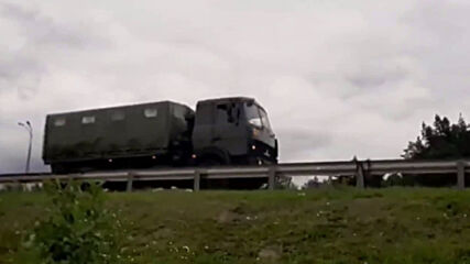 Belarus: Buses and military trucks stream towards Minsk
