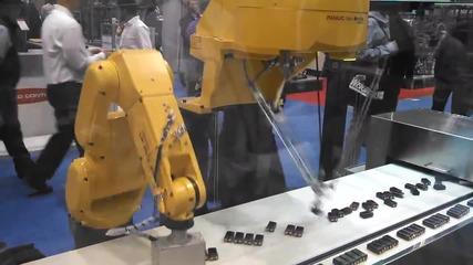 Fanuc роботи опаковат батерии