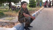 Syria: Fighters and civilians board evacuation convoy headed towards Aleppo