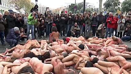 Spain: Naked and bloodied activists stage anti-fur protest in Barcelona