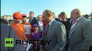 Russia: Putin explains rouble exchange rate to 11-year-old boy on Sochi visit