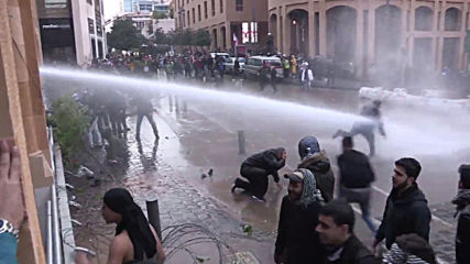 Lebanon: Police fire water cannon, protesters hurl tree branches in Beirut