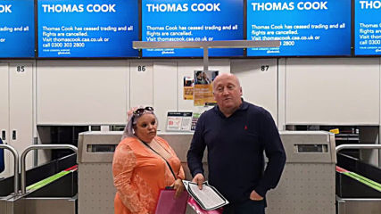 UK: Thomas Cook passengers arrive at empty check-in desks at Gatwick airport