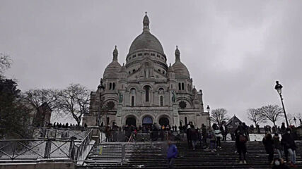France: Parisians sled and ski down Montmartre slopes after snowfall