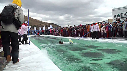 Sink or skim?! Insane Siberian skiers try to skip over ice-cold pool