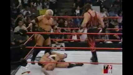 Kane and Rikishi vs The Rock and Two referees