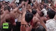 Greece: Self-flagellating Shia Muslims mark Ashura with bloody ceremony