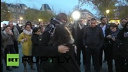 France: Blindfolded Muslim man hugs mourners in Paris