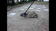 Blisstool Ltc64x v2 - Полеви тест 9 - Засичане на монета разположена под мин. камък с дебелина 23 см