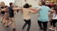 Dancing Zorbas in street -