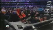 Vince Mcmahon does a Leg Drop off a Ladder through the Announcer Table
