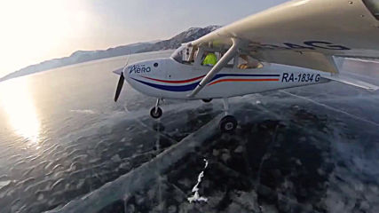 Russia: Breathtaking landing on frozen Lake Baikal caught on video