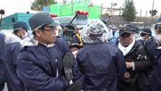 Japan: Police evict sit-down protest as trucks roll in to build US base