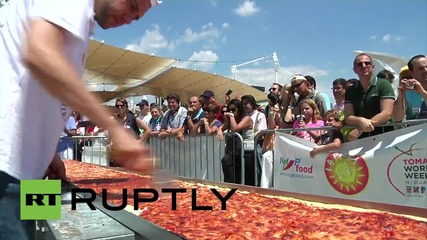 Italy: Margherita GALORE! The world's longest pizza is 1.5 km long