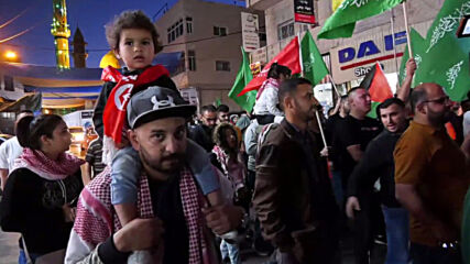 State of Palestine: Protesters march in Hebron in solidarity with Gaza