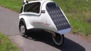 Триколка с електрическо-педално движение покрита с фотоволтаици да й зареждат акумулаторите