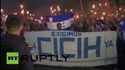Honduras: Thousands at torch-lit anti-corruption march call for officials to resign