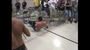 Seth Rollins of The Shield moonsault off wrestling fan