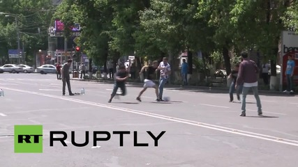 Armenia: Utility protesters play football in Yerevan's barricaded streets