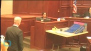 Holmes Shows No Emotion As Judge Reads Verdict