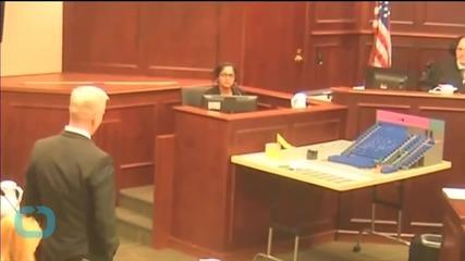 Holmes Shows No Emotion As Judge Reads Verdict