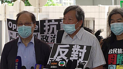Hong Kong: 13 activists appear in court over Tiananmen vigil