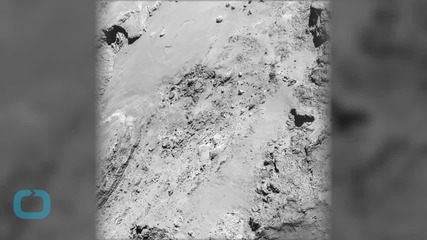 A Rock is Teetering on a Comet's Surface, But How it Got There is a Mystery