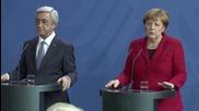 Germany: Merkel calls for Karabakh truce, Armenian pres blames Baku