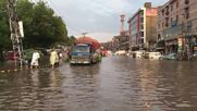 Pakistan: Lahore streets flooded after heavy rainfall with people struggling to walk through knee-deep water
