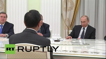 Russia: Putin meets Chinese FM ahead of Xi Jinping visit