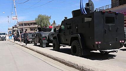 Syria: Smoke rises in Qamishli amid clashes between Kurdish and pro-govt forces