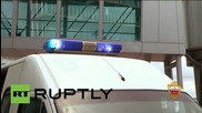 Russia: Polonsky greeted by armed police after touching ground in Moscow