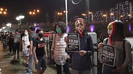Hong Kong: Students defy anti-ban mask as protests enter 19th weekend