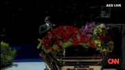 Usher chokes up at memorial