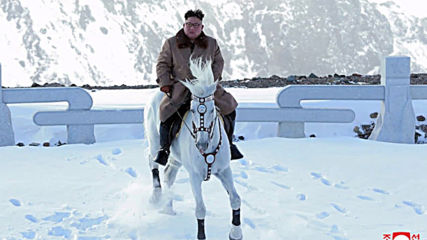 Kim Jong-un rides white stallion up sacred mountain *STILLS*