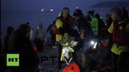 Greece: Refugees reach Lesbos as night falls on the Mediterranean