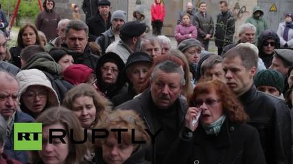 Ukraine: Mourners attend murdered journalist Oles Buzina's funeral *GRAPHIC*