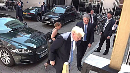UK: Newly chosen UK PM Boris Johnson arrives at Conservative party HQ