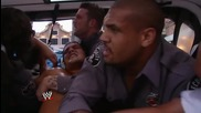 Bo Dallas is escorted out of the building kicking and screaming