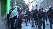 Italy: 40 refugees detained after police raid on refugee centre