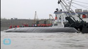 Operation Begins to Lift China Ship